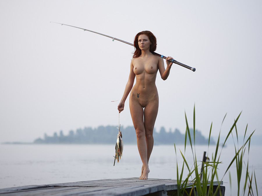naked-girl-fish-strapon-hand-job
